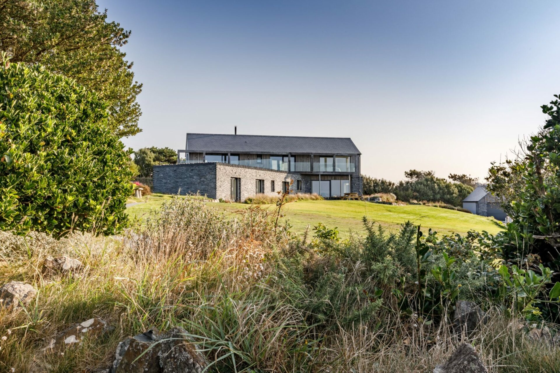 ARCO2 in Bodmin designed this fantastic sustainable home with views across Polurrian Bay